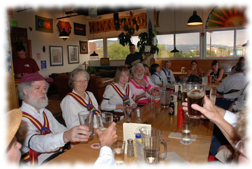 The Maroon Bells Morris Dancers relaxing with the traditional beverage of morris dancing: beer!